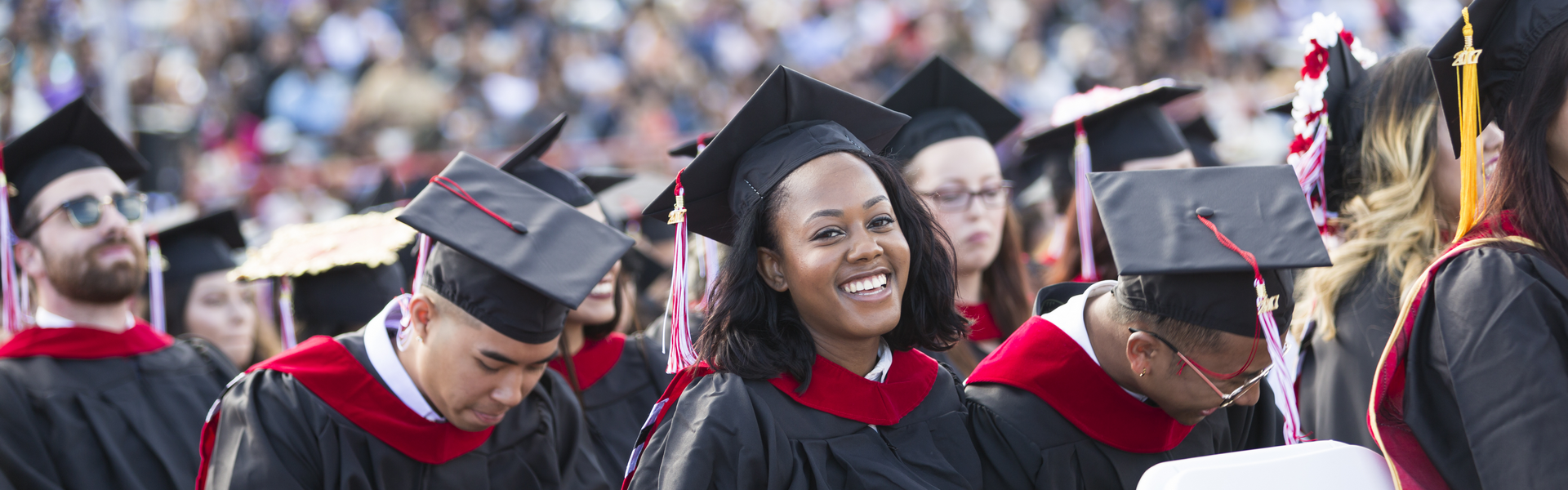 Students in their cap and gowns at a commencement ceremony.