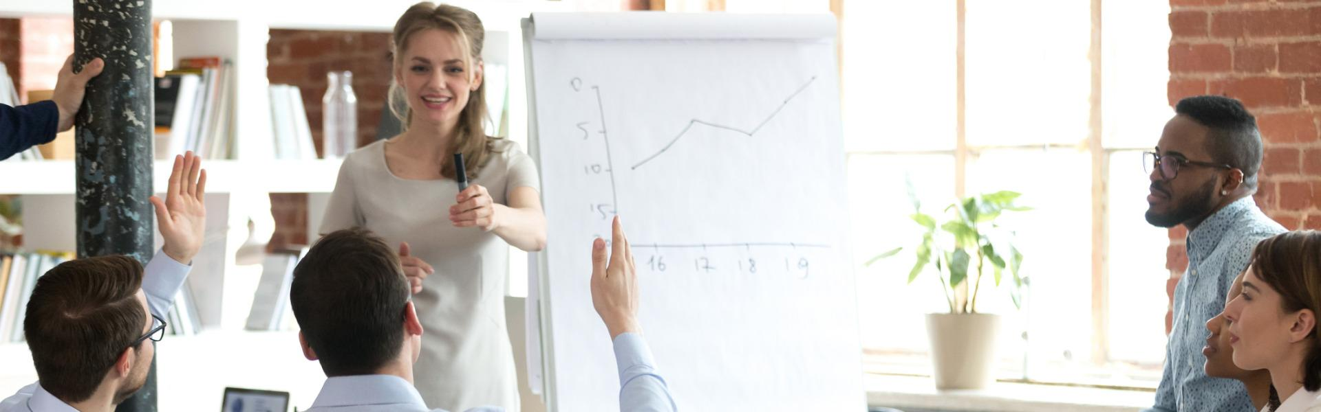 female mentor invite employee present idea on flipchart