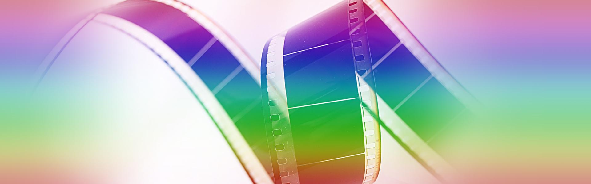 A rainbow-colored film reel.