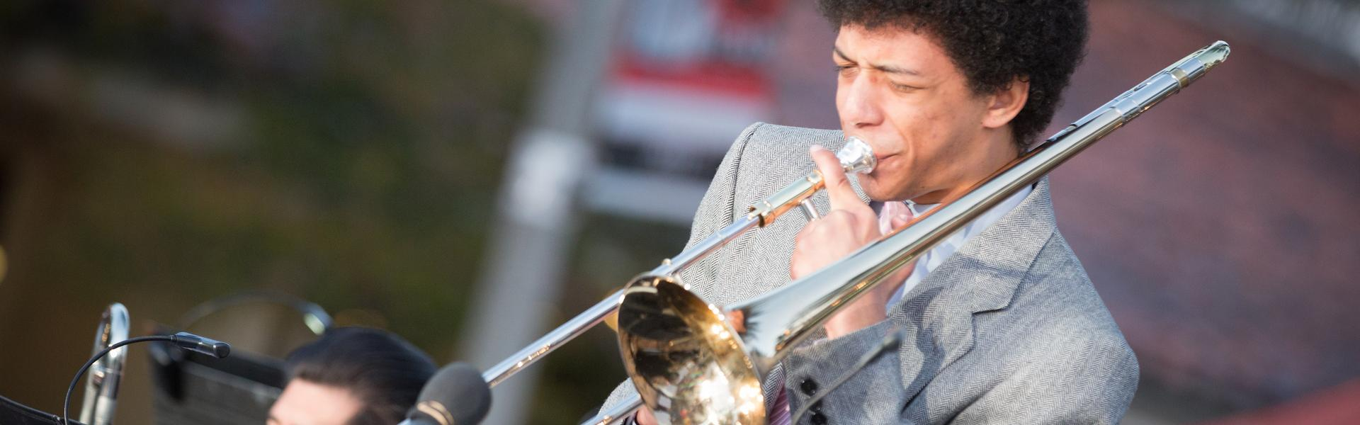 A musician playing the trombone.