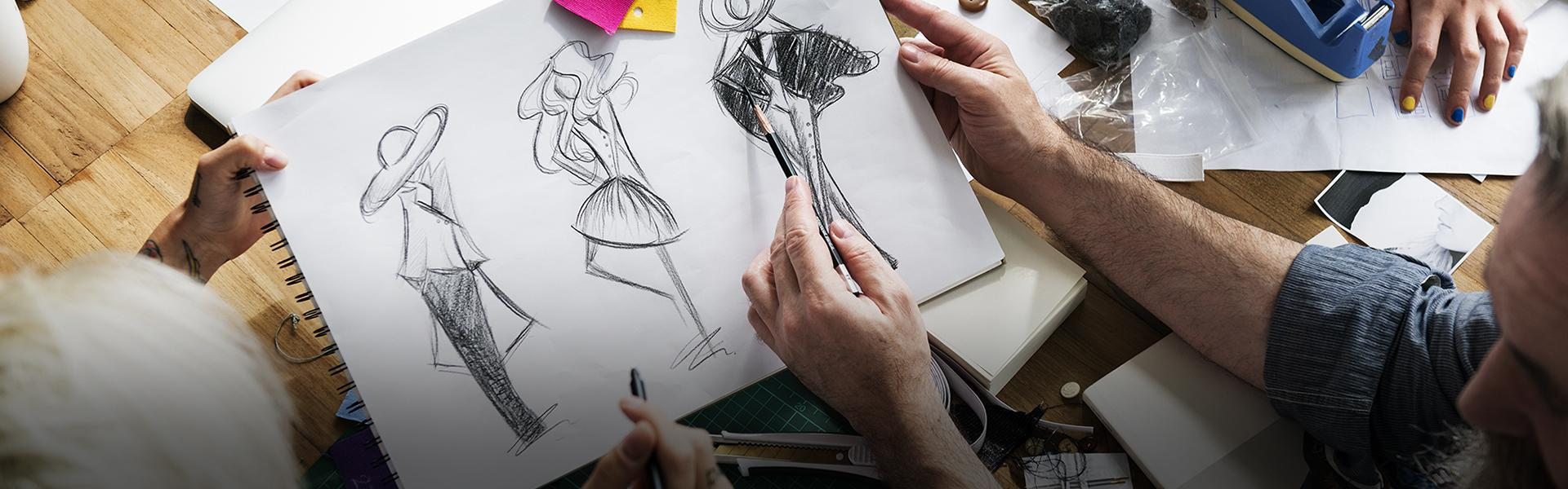 A person sketching fashion designs.