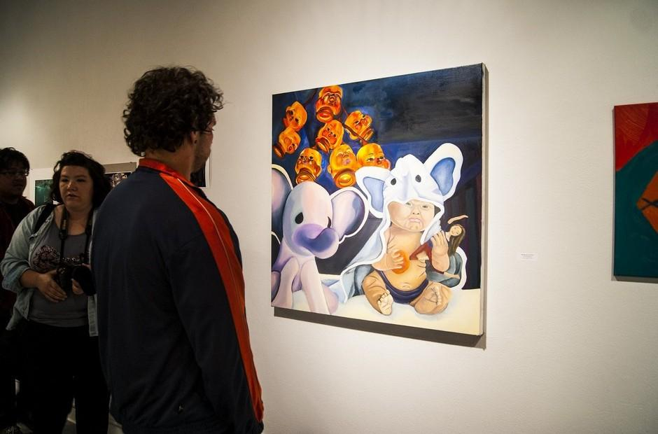 A man looking at a student painting.