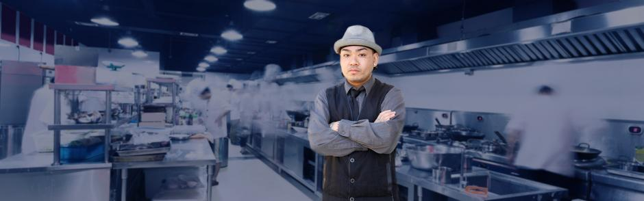 A picture of Chef T standing in a restaurant kitchen.