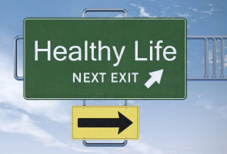 Healthy Life freeway sign with arrow pointing to the blue sky