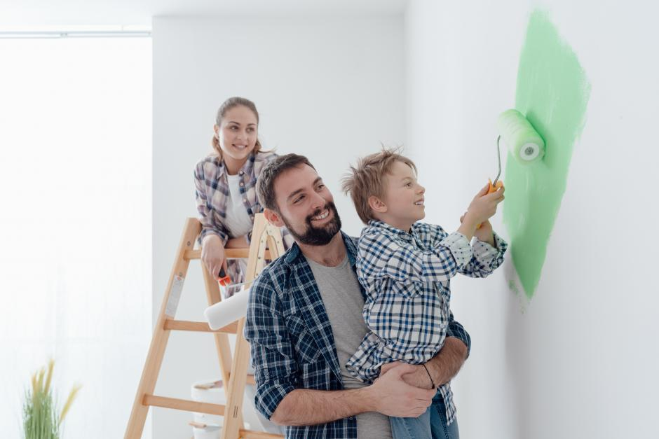 Family painting a room together