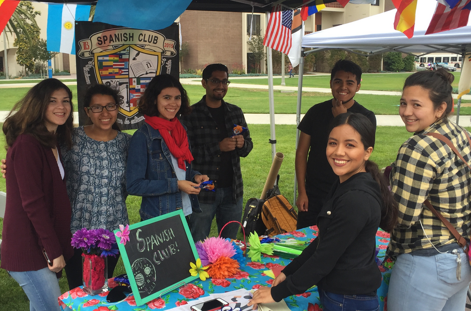 Students standing in front of the Spanish Club table.