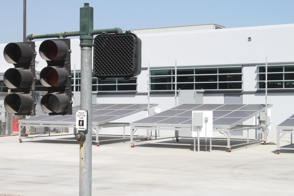 An courtyard outside the Electrical Technology building with traffic signals and solar panels used for teaching purposes.