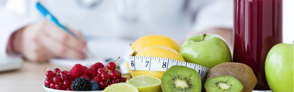 Nutritionist desk with fruit and measuring tape