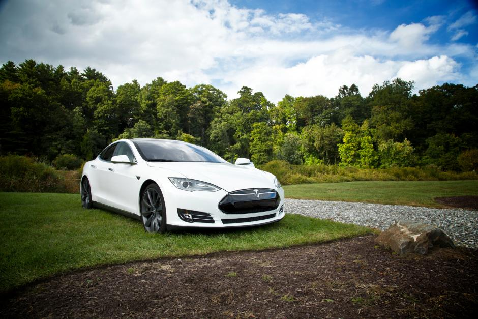 Tesla parked on grass