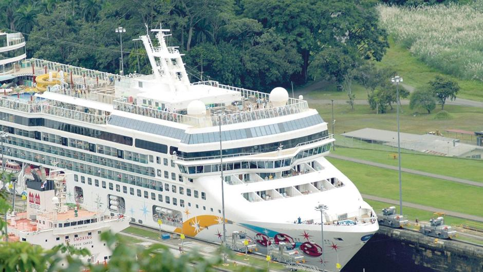 A cruise ship sailing through the panama canal