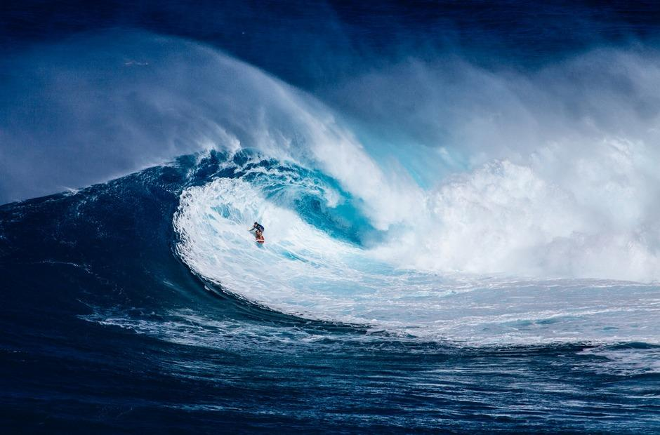A surfer riding a big wave.
