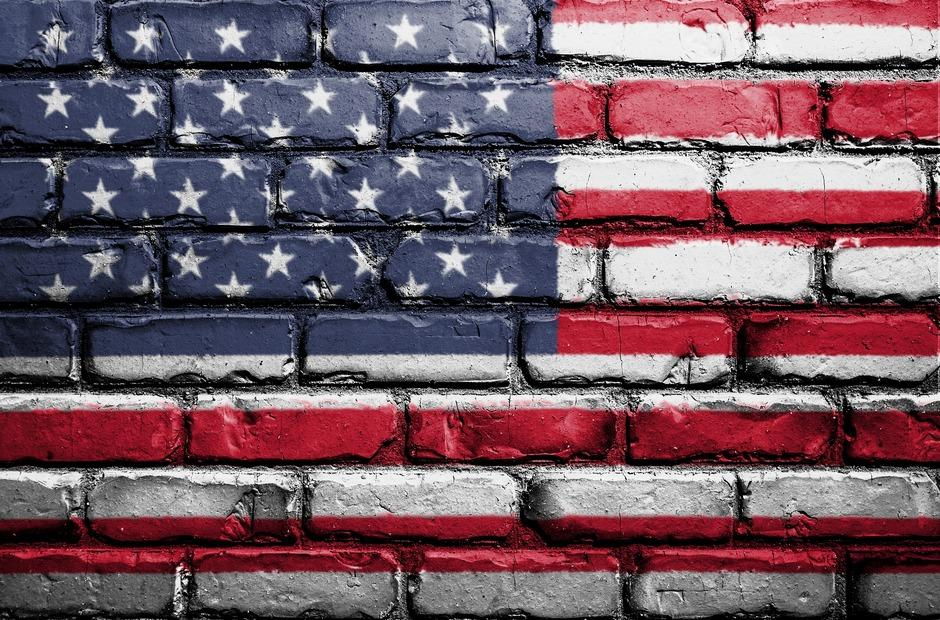 The U.S. Flag on a brick wall.
