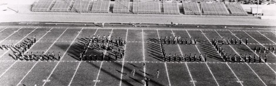 A vintage photo of the LBCC Marching Band at Veteran's Stadium.