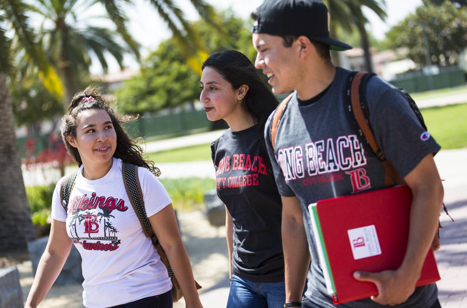 Three students walking through campus.