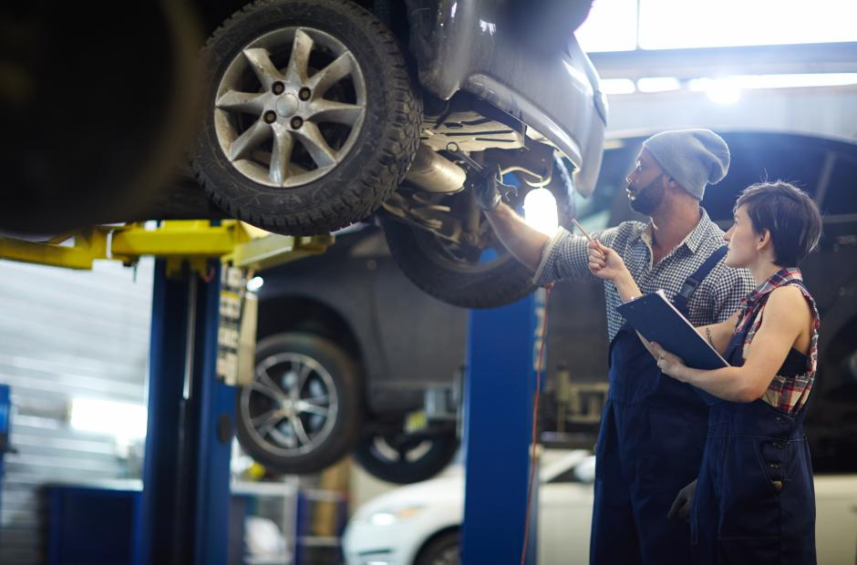A women and a man working in auto shop in Automotive Repair Session