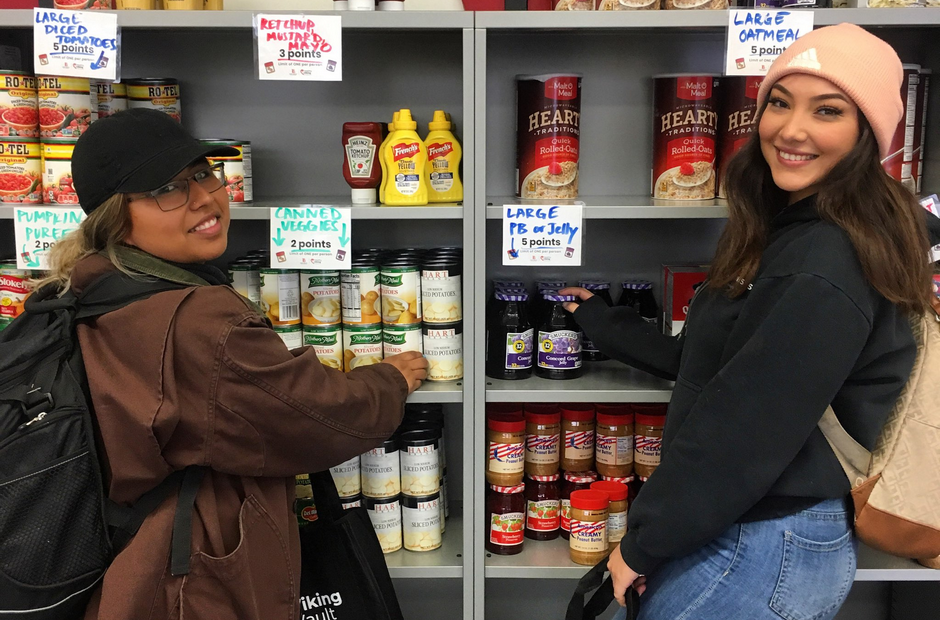 Two LBCC students standing in front of a shelf of food.