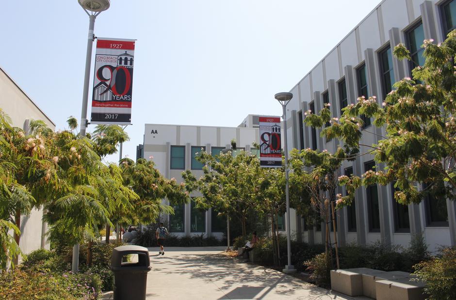 A Walkway Between Various Buildings On The Pcc Campus
