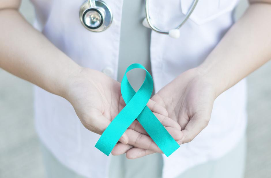 Teal ribbon awareness on doctor's hand for sexual assault awareness