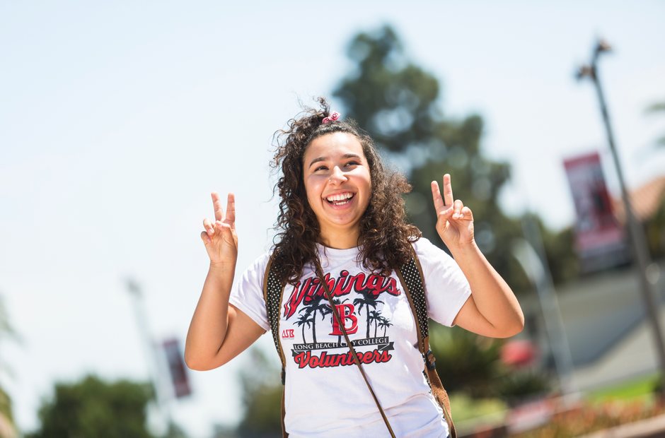 An LBCC student flashing the #2 with her fingers.
