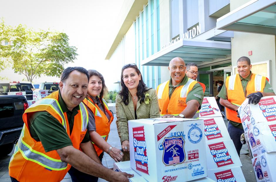Trustee Zia with Carpenters delivering food