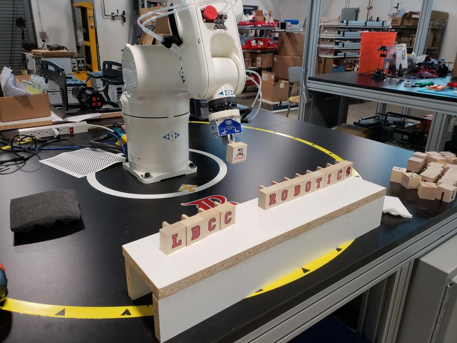 LBCC Robot arm displaying wood block
