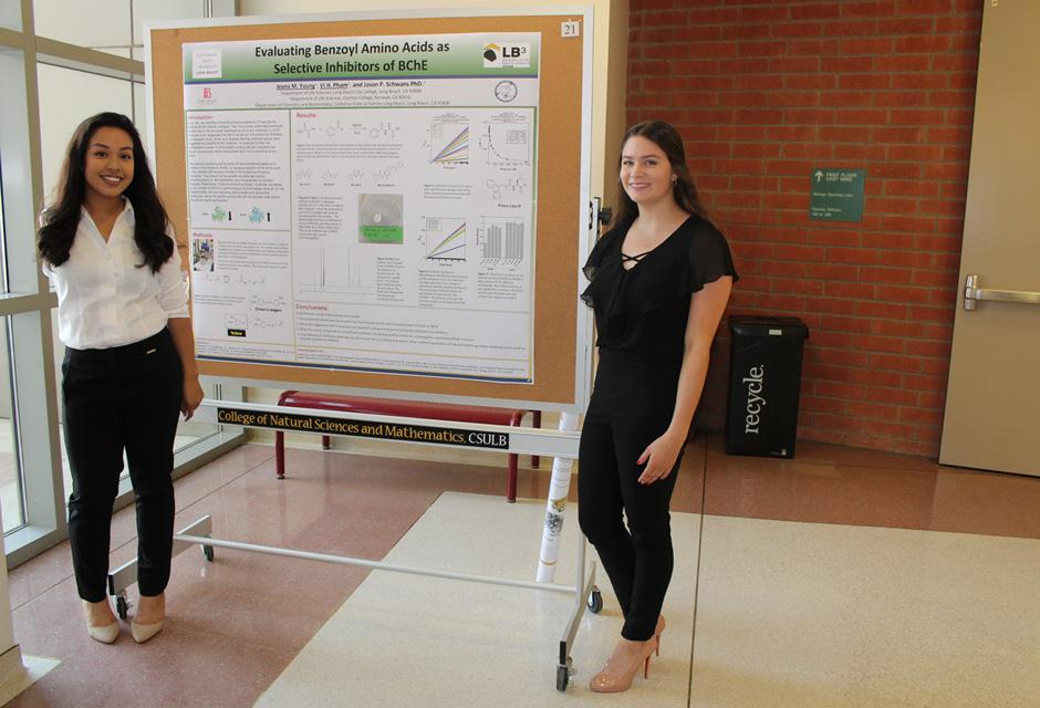 Two LBCC students standing next to their science research board in the Bridges to the Baccalaureate Program