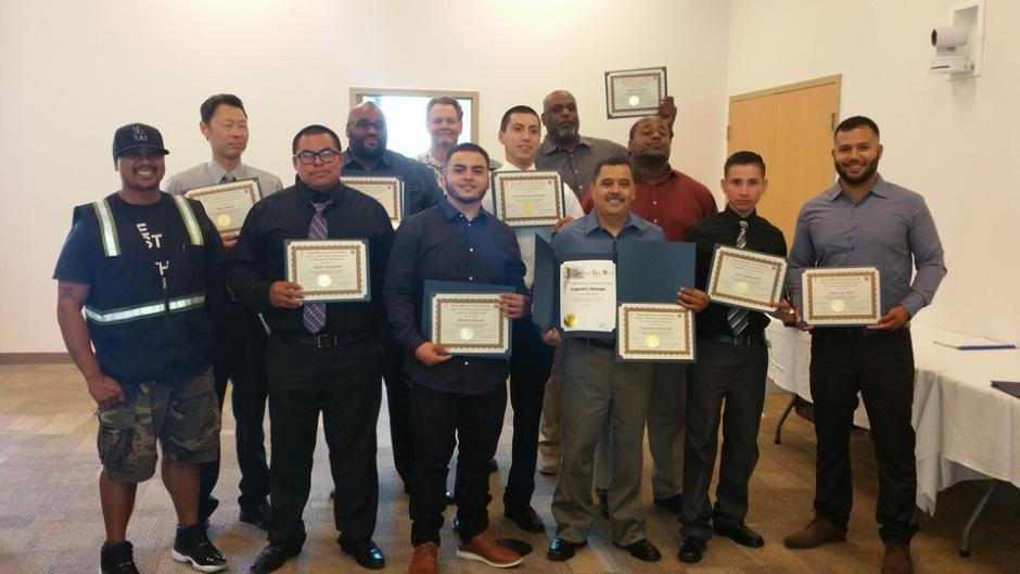 A group picture of participants in the Commercial Truck Driver program.
