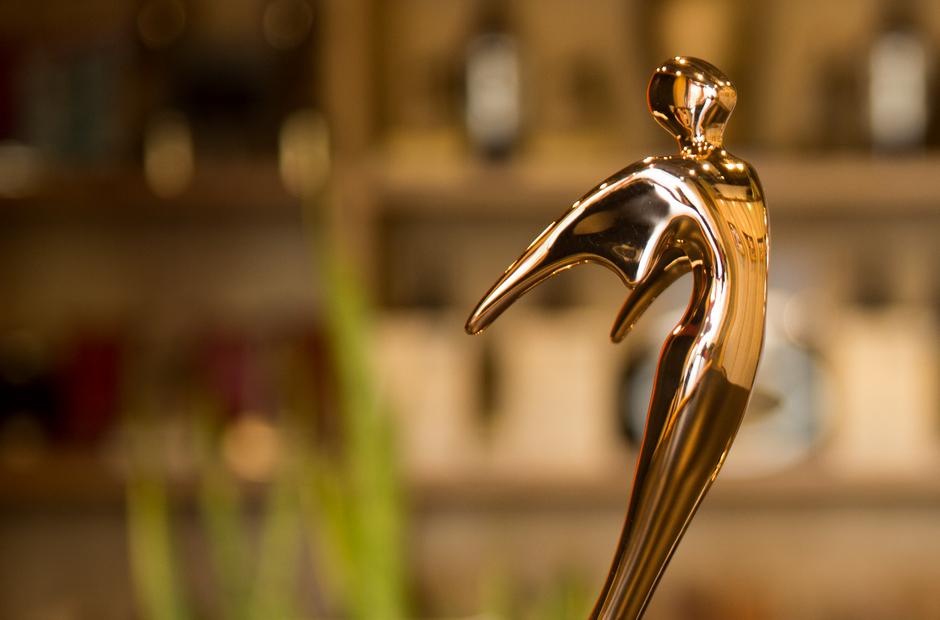 A picture of a golden Telly Award statue.