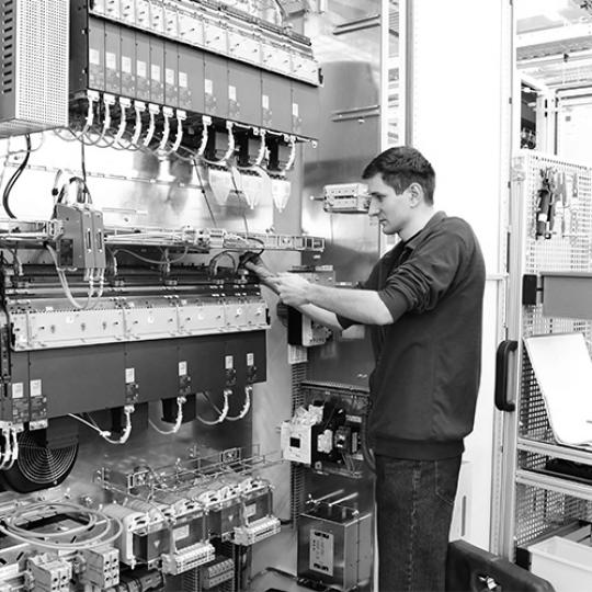 Man operating electrical machine