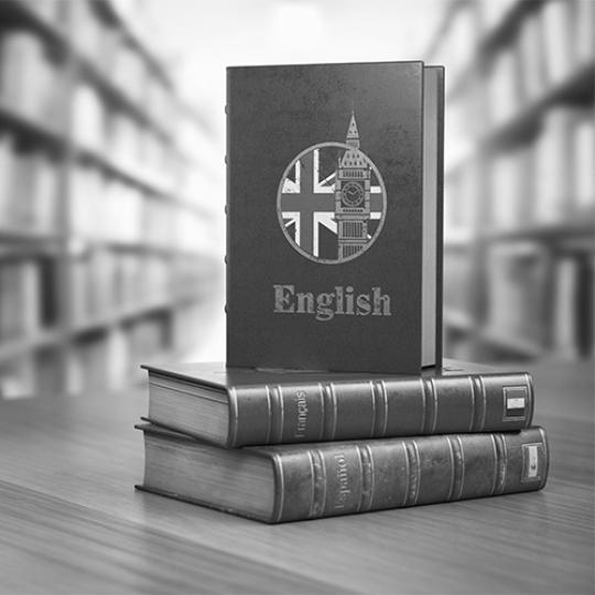 Learn English concept. English dictionary book or textbok with flag of Great Britain and Big ben tower on the cove in the library