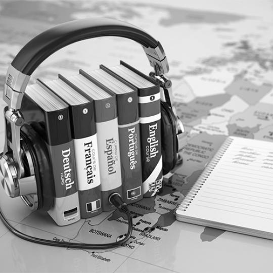 Learning languages online. Audiobooks concept. Books and headphone