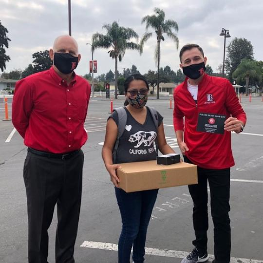 LBCC Staff handing out Chromebooks.