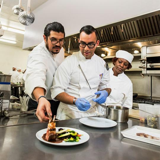 LBCC students making steak in Culinary Arts program